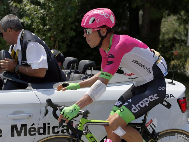 A bandaged Rigoberto Uran gets medical assistance during the 10th stage. Picture: AP