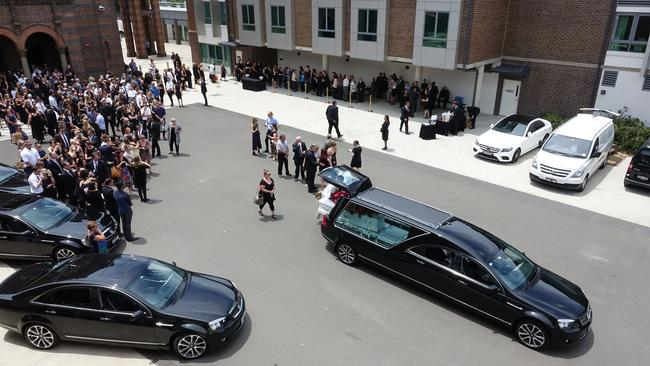The coffin is put into the hearse at the funeral for Jessica Falkholt. Picture: AAP /Ben Rushton.