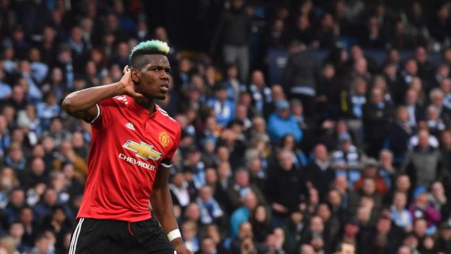 Manchester United's Paul Pogba celebrates scoring against Manchester City