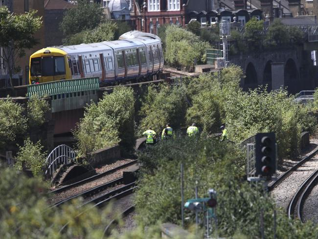 Police officers on a railway track near Loughborough Junction. Picture: AP
