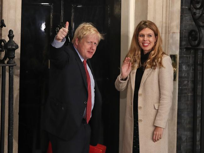 Boris Johnson and his partner Carrie Symonds enter via a the front door – something that didn't happen when Boris Johnson first entered as Tory leader in July. Picture: AP Photo/Thanassis Stavrakis.