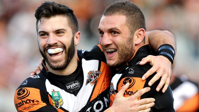 Tigers stars James Tedesco and Robbie Farah celebrate a try.