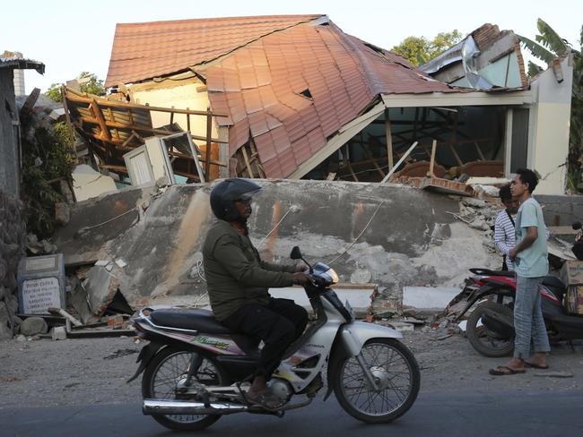 Houses heavily damaged by an earthquake in North Lombok, Indonesia.