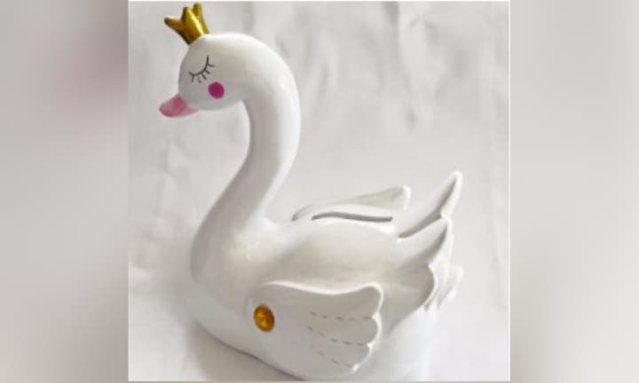 <b>SWAN MONEY BOX by frombabytokids.com.au $19.95.</b>  <p>A cute way to start your baby's life savings. Sure, you'll need a little more than loose change to raise this kid, but maybe in six months you can raid it and buy yourself a coffee. Better still, start a 'gold coin for cuddles' scheme with the endless stream of visitors you'll be receiving over the first few months. </p>