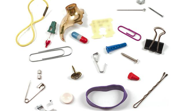 Bunch of household items that are hazardous to children. Choking hazards or sharp objects. Isolated on white.