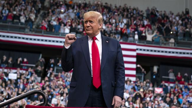 US President Donald Trump arrives at SNHU Arena for a campaign rally on February 10, 2020, in Manchester, New Hampshire. Picture: AP Photo/Evan Vucci