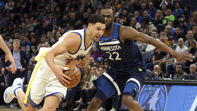 Golden State Warriors' Klay Thompson drives around Andrew Wiggins.