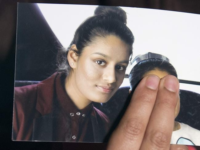 Renu Begum, eldest sister of Shamima Begum, holds a picture of her sister. Picture: AFP