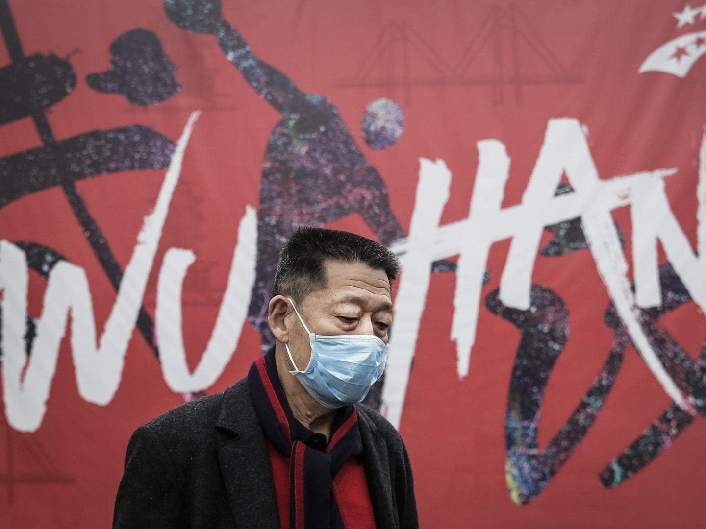 A masked man walks the streets of Wuhan. Picture: Getty Images