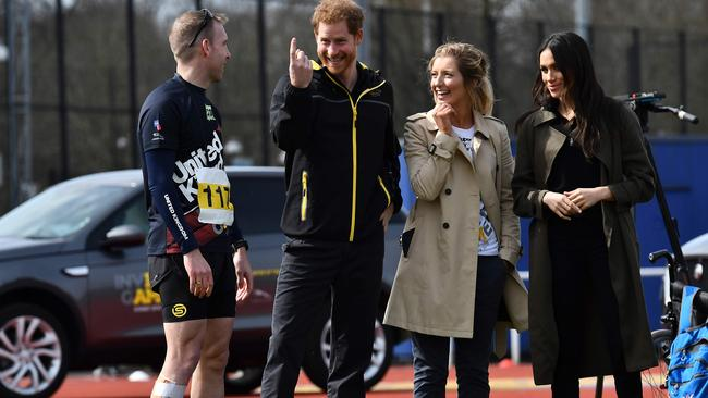 Prince Harry (second from left) and his wife Meghan (right) with Invictus Games UK Team chef de mission Jayne Kavanagh. Picture: Ben Stansall/AFP