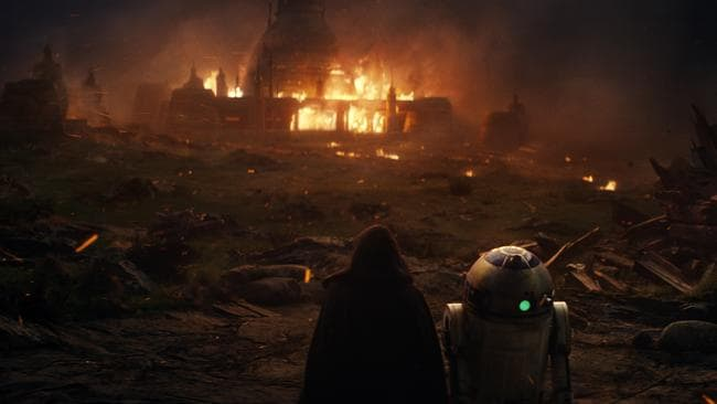 R2D2 to a mysterious hooded figure in the new film. Picture: Industrial Light & Magic/Lucasfilm via AP