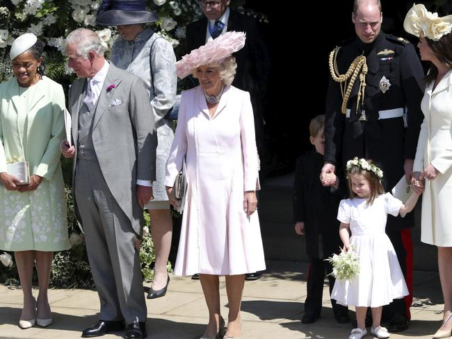 Doria Ragland, the Prince of Wales, the Duchess of Cornwall, the Duke and Duchess of Cambridge with Prince George and Princess Charlotte leave after the wedding. Picture: AP