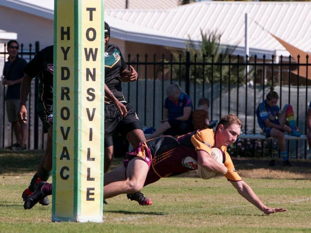 Bailey Bliss crosses the line for the Charters Towers Miners against the Gowrie Warriors in the in their Under 17s game in round 12 on the weekend.
