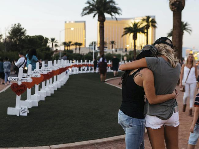 A memorial at the Welcome To Las Vegas sign in tribute to the victims of the shooting. Picture: Mikayla Whitmore/Las Vegas Sun via AP