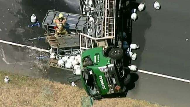 Aerial shot of the truck lying on its side with gas cylinders strewn about. Picture: 9 News