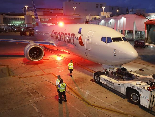 A grounded American Airlines Boeing 737 MAX 8 is towed to another location at Miami International Airport. Picture: Joe Raedle/Getty Images/AFP