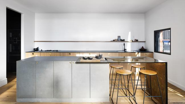 The kitchen features Gaggenau and Wolf appliances, and a butler's pantry.