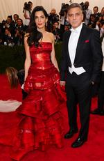 "Amal Clooney, left, and George Clooney attend the Met Gala 2015 ""China: Through The Looking Glass"". Picture: AP"