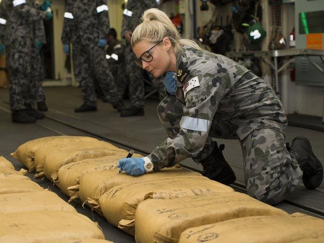 Leading seaman naval police Coxswain Jamie Janes as she numbers narcotic parcels seized by HMAS Warramunga. Picture: AAP Image/Supplied/Australian Navy