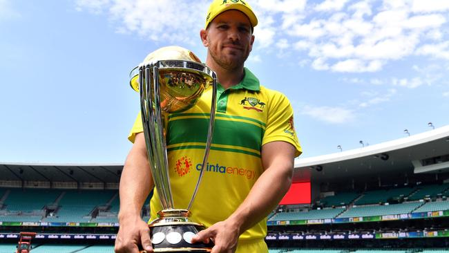 Australian captain Aaron Finch and the prize Australia are defending. Picture: AFP