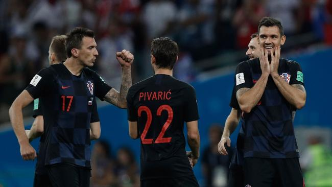 Croatia's players celebrate scoring a penalty during the Russia 2018 World Cup quarter-final.