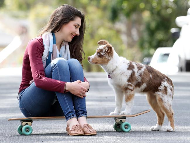 Tamika Lucock shares a skateboard with Luna. Picture: David Swift