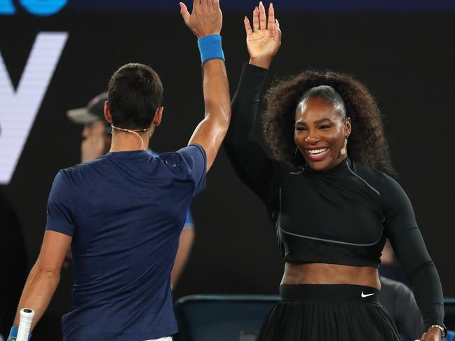 Serena Williams high 5s Novak Djokovic at the 'Rally for Relief' bushfire appeal fundraiser on Rod Laver Arena in 2020. Picture: Michael Klein