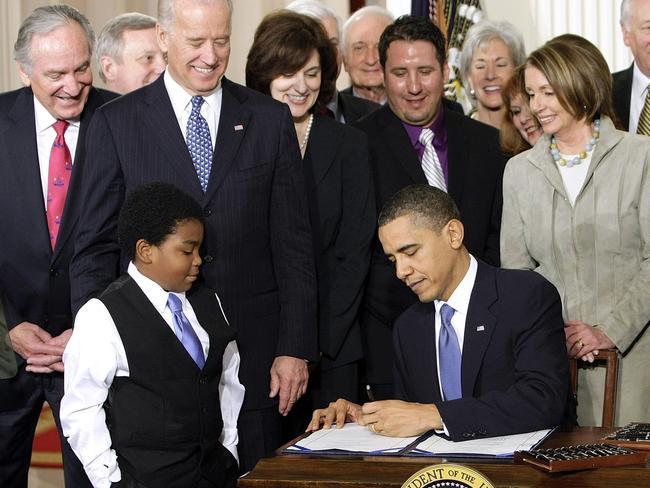 President Barack Obama signs the health care bill in 2010. Picture: AP Photo/J. Scott Applewhite, File