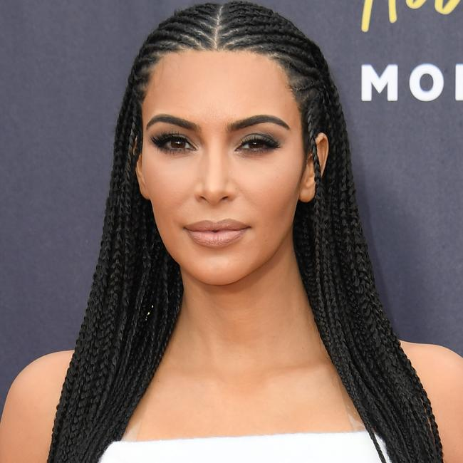 Kim Kardashian-West was criticised in 2018 after she appeared at the MTV Movie and Television awards with her hair in cornrows. Photo by Valerie Macon/ AFP)