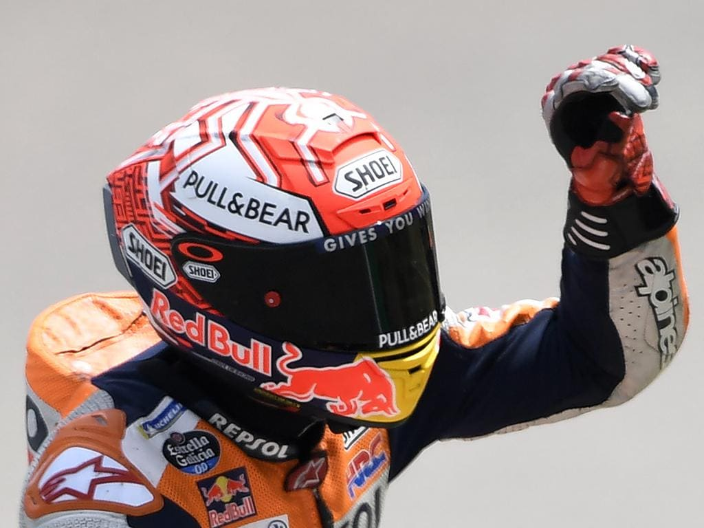 MotoGP Honda rider Marc Marquez of Spain waves after winning the MotoGP qualifying at German Motorcycle Grand Prix at the Sachsenring circuit in Hohenstein-Ernstthal, Germany, Saturday, July 6, 2019. (AP Photo/Jens Meyer)