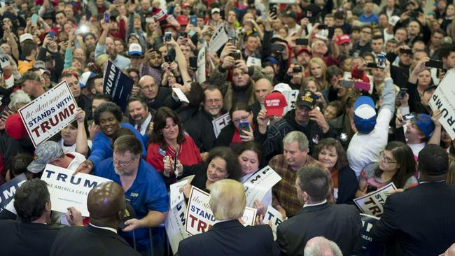 Kentucky Republican supporters mob Donald Trump in Louisville during his campaign to become the party's candidate for president back in March this year. Picture: Aaron P. Bernstein/Getty Images
