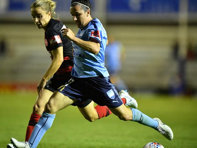 Sydney FC's Lisa De Vanna on the ball in front of the Wanderers' Olivia Price on Thursday night. Picture: AAP