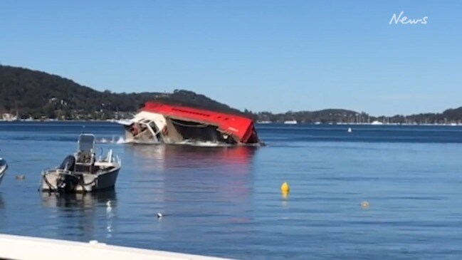 Barge with wastewater truck overturns in Pittwater