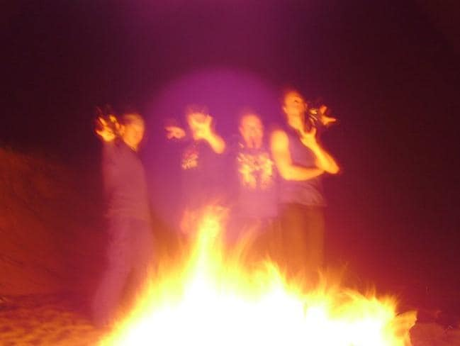 Australian Satanists gather around a bonfire for a ritual