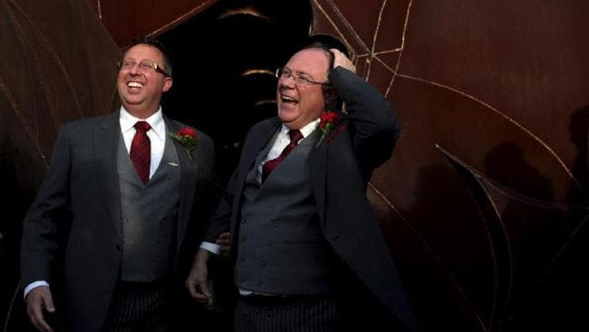 Australian Minister Ian Hunter, right and Leith Semmens react as they leave the Pabellon de los Artes center after getting married in the town of Jun, southern Spain, last December. Hunter, a Labor minister in the South Australian government, married his longtime partner in southern Spain, two months after Australia voted down a proposal to enact same sex marriage legislation. He is believed to be the first sitting member of an Australian legislative body to marry a gay partner.