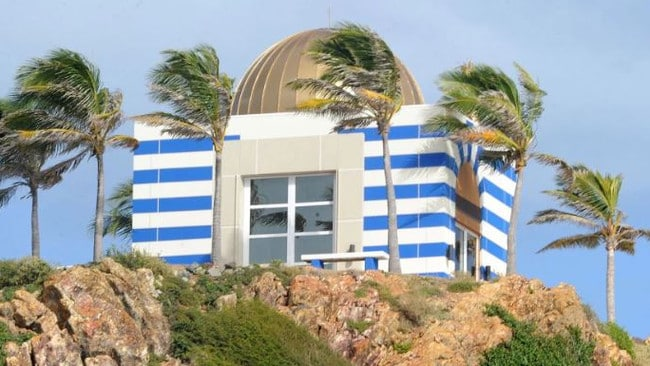 Structures on the island include a mansion and a bizarre blue and white temple. Picture: Splash News