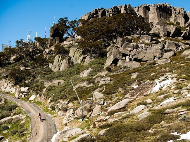 Bike riders zigzag down the mountain.