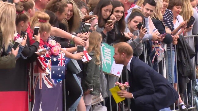 Harry and Meghan greeted by crowds in Melbourne at Government House