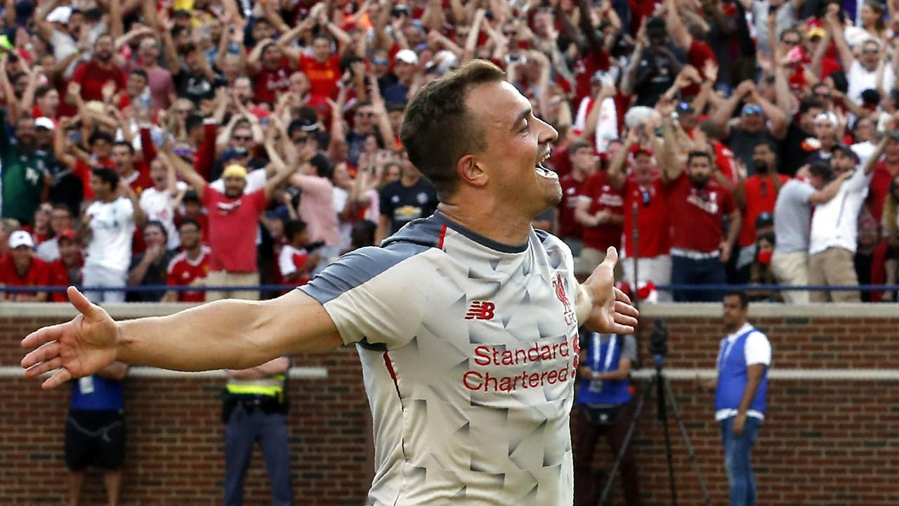 Liverpool's new signing Xherdan Shaqiri celebrates after scoring against Manchester United in the new third kit.
