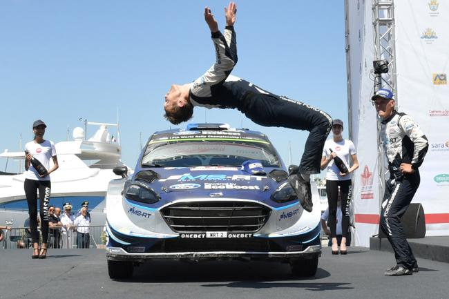 Tanak watches co-driver Jarveoia celebrate their win with a backflip.