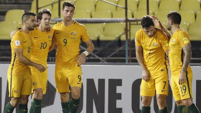 Australia's Robbie Kruse, second from left, celebrate with teammates.