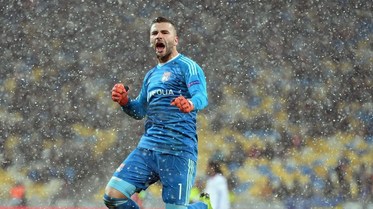 Lyon's Portuguese goalkeeper Anthony Lopes reacts after his side clinched progression.
