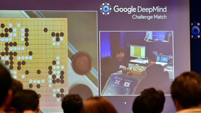 Journalists watch a big screen showing live footage of the third game of the Google DeepMind Challenge Match between Lee Se-Dol, one of the greatest modern players of the ancient board game Go, and the Google-developed supercomputer AlphaGo. Picture: Jung Yeon-Je