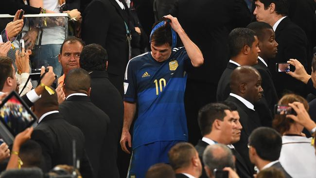 Lionel Messi of Argentina takes his medal off after being defeated by Germany 1-0 during the 2014 FIFA World Cup Brazil Final.