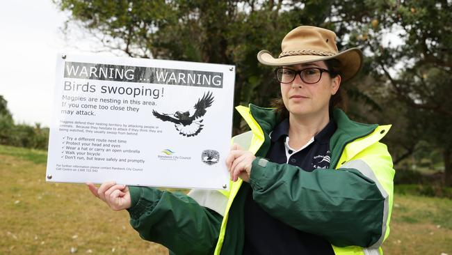 Ranger Leanne Bunn with one of the warning signs. Picture: AAP