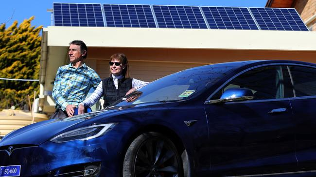 Simon Claringbold and wife Heather and their Tesla Model S. Picture: Ray Strange.