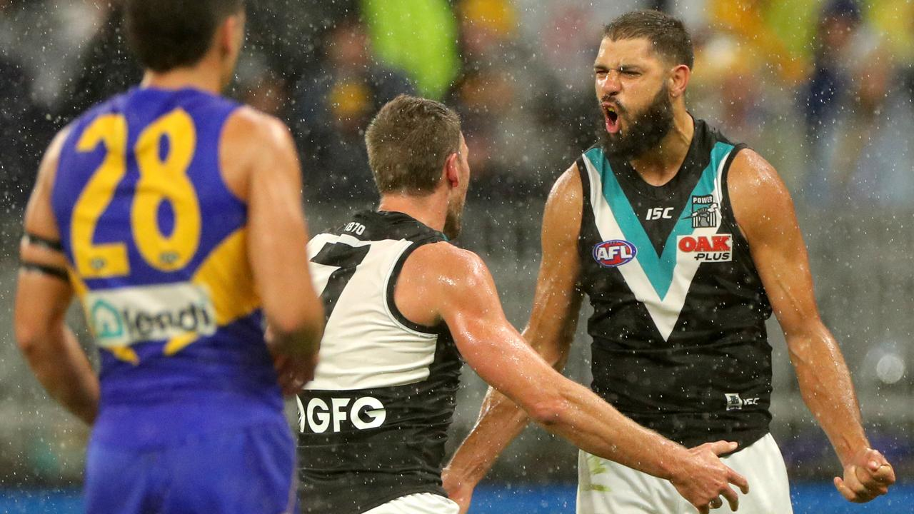 Paddy Ryder (right) of the Power is congratulated by Brad Ebert (AAP Image/Richard Wainwright)