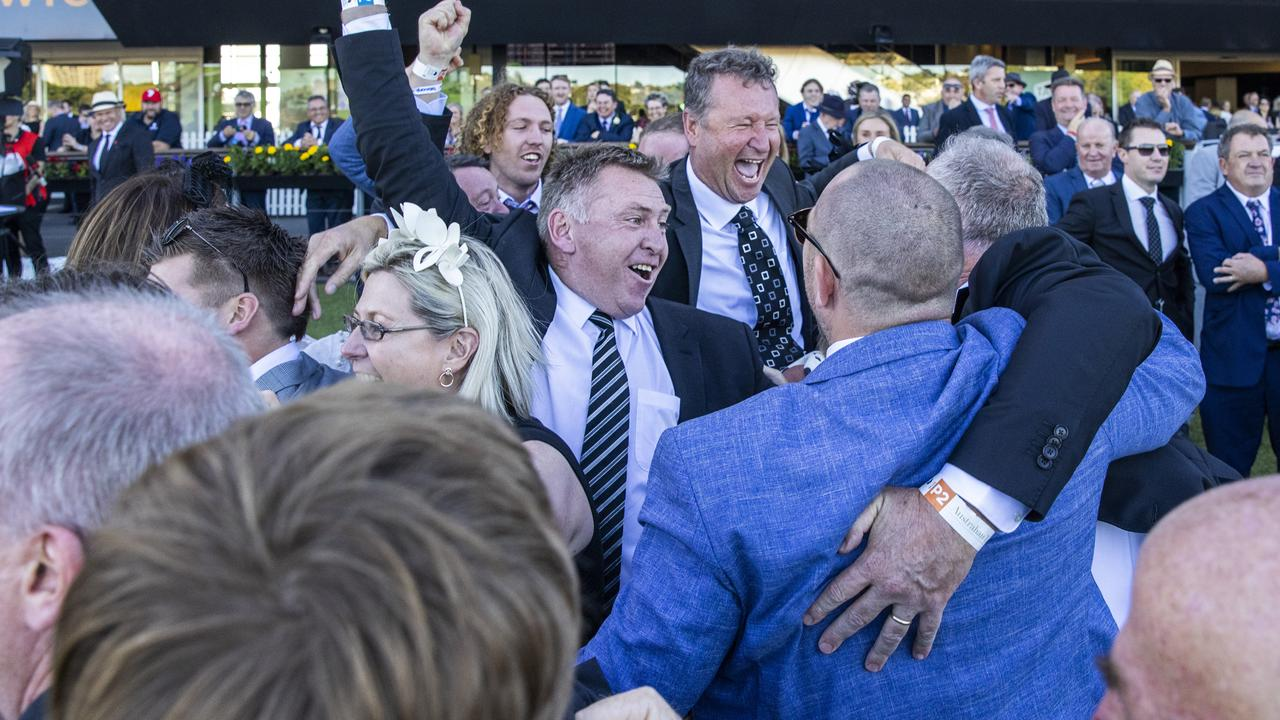 Connections of Explosive Jack are ecstatic after winning the Australian Derby. Picture: Getty Images