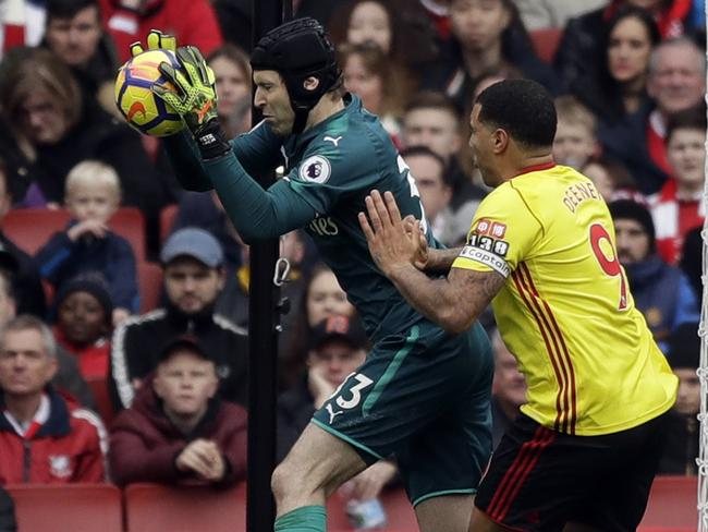 Arsenal goalkeeper Petr Cech, left, makes a save in front of Watford's Troy Deeney