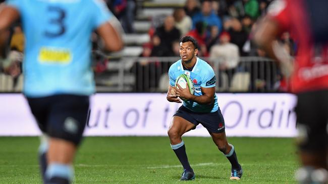 Kurtley Beale of the Waratahs charges forward at AMI Stadium in Christchurch.